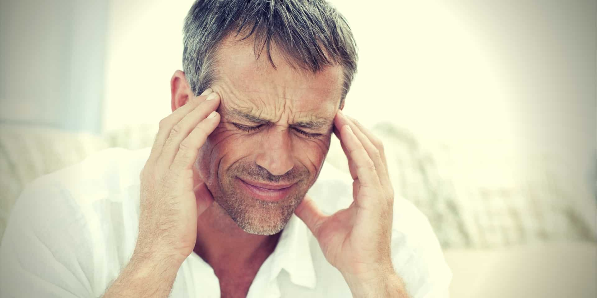 Kratom Headache Man having a headache at home